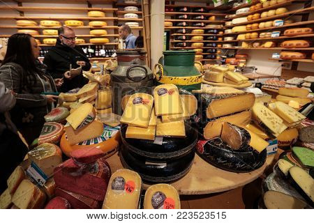 ALKMAAR, NETHERLANDS - APRIL 21, 2017: Display of traditional Dutch cheese, like Edam and Gouda cheese  at local cheese shop, Alkmaar, the Netherlands