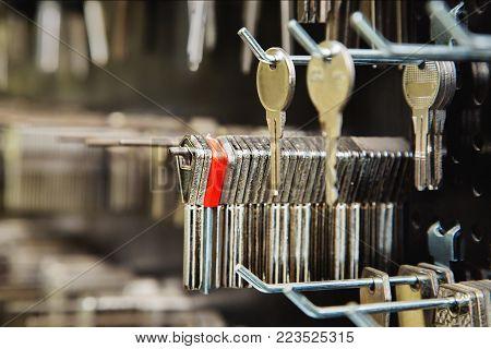 Blank keys on a special  wall in a key cutting workshop