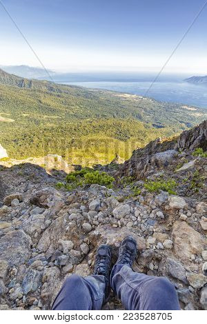 Portrait view of a hikers legs near the summit of Mount Egon, an active stratovolcano on East Nusa Tenggara in Indonesia.