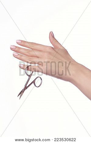 woman cuts nails scissors, close up. on a white background