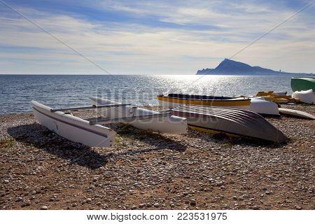 catamaran on the beach. boats on the pebble beach.
