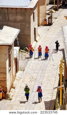 Shangri-la, China - September 25, 2017: Women Walk The Road In Songzanlin Monastery, Built In 1679,