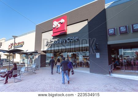 RICHARDSON, TX, USA-JAN 20, 2018:Customers enter 85 C Bakery Cafe. A Taiwanese chain of coffee shops and self-serve bakeries operated by Gourmet Master Co., Ltd, founded in 2003 by Wu Cheng-Hsueh