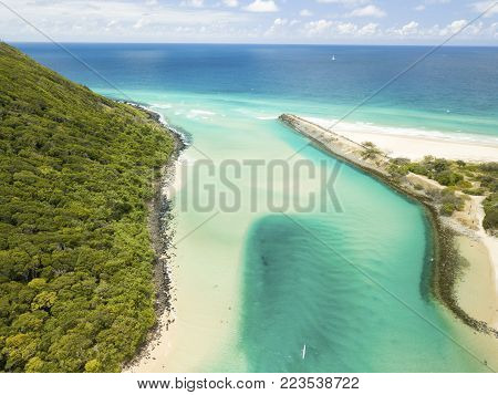 Aerial photograph of the Tallebudgera Creek inlet with the Burleigh Heads headland on the edge of frame. Gold Coast, Queensland, Australia.