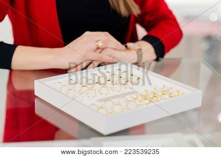 Attractive Woman Showing A Collection Of Wedding Rings
