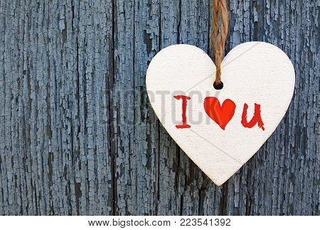 Valentines Day holiday background.Decorative white wooden heart with I love You inscription.I Love You,St Valentine's Day or Love concept.Selective focus.