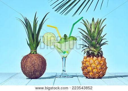 Tropical Pineapple and Coconut. Bright Summer Color. Cocktail on Beach. Hot Summer Vibes. Sunny background. Trendy fashion Style.