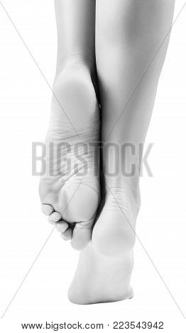 Healthy female feet isolated on white background. Foot care concept. Isolated on white.