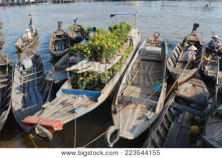CAI BE, VIETNAM - FEBRUARY 16, 2007: View to the boats floating on water at the floating market in Cai Be, Vietnam. Cai Be is often called Venice of Indochina.