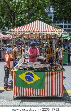 Belo Horizonte, Brazil - Dec 23, 2017: Arts and crafts on display for sale at a street market in Belo Horizonte, Minas Gerais, Brazil