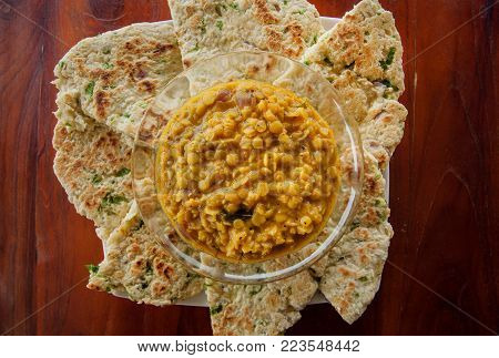 Indian food for fast snack, roti bread and vegetarian dal made from lentils or beans. Also food popular in Nepalese, Pakistani, Sri Lankan and Bangladeshi cuisines.