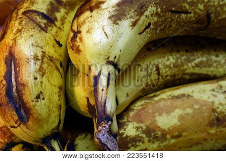 Over ripe bananas close up as background image.