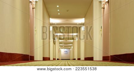Hotel corridor low angle view. Selective focus