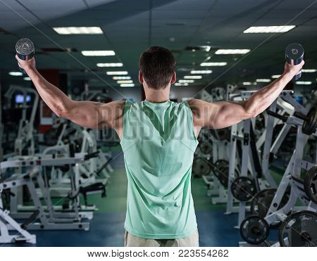 Very Power Athletic Guy Bodybuilder, Execute Exercise With Dumbbells