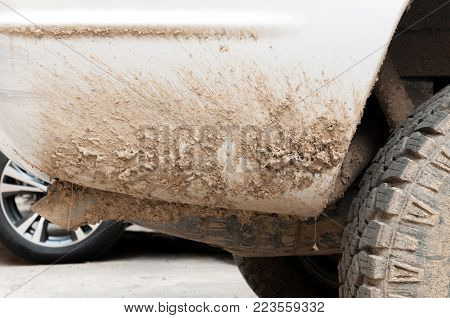 Dirty car. Extremely dirty white off road 4x4 car with lot of dirt,  mud and dust on rear end from driving through wet ground and nature close up