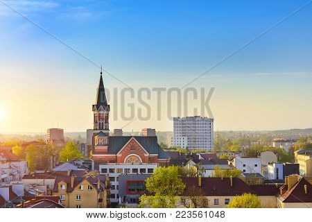 Catholic Church of St. Wojciech in Bialystok, Poland. Gothic architecture of red brick - religious memorial and place of worship. Early morning sunrise
