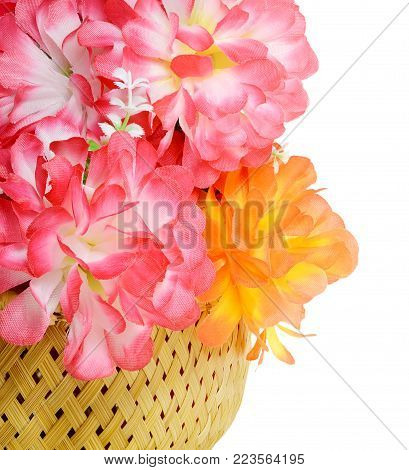 The picture of the basket with a beautiful big bouquet of Artificial flower rose peony red white yellow and orange bright color made of synthetic fabric and plastic. Items pictured close up isolated on white background.