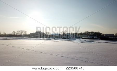 Winter field panorama. winter panorama on the road through coniferous forest. Winter view. Snow-capped evergreen trees and snowy slopes in sunny cold day. Panorama.
