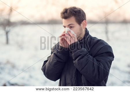 Handsome Man Blows His Nose
