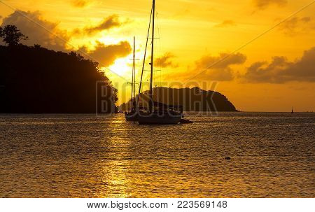 The caribbean sea sunset and sailboats, Martinique island French West Indies.