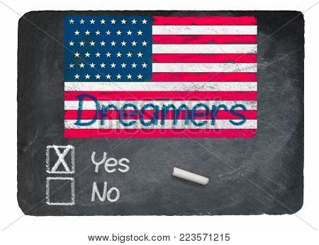 Dreamers Yes Vote message written in chalk on a chalky natural slate blackboard for current debate over Dreamers