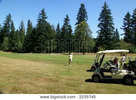 Woman Golfers And Carts