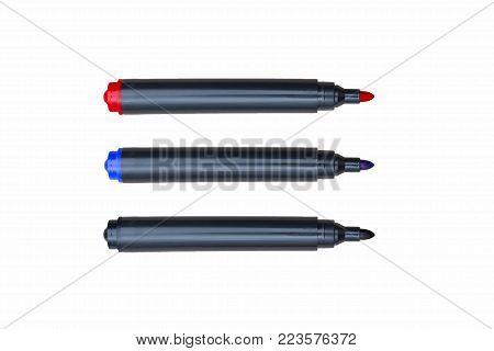 three felt-tip pens, on white background, close-up, black, blue, red