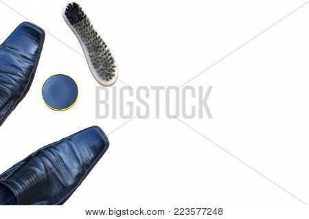 old shabby men's black shoes. shoe polish and a new shoe brush. on a  white background  view from above. insulated, place for inscription
