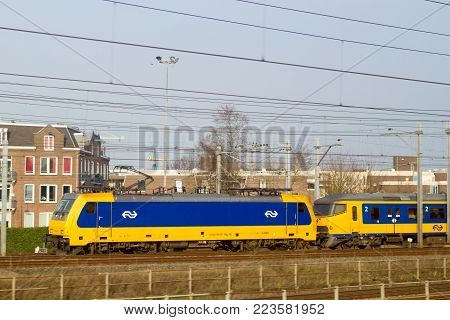 Amsterdam Centraal Station, the Netherlands - 28 March 2017: Dutch electric intercity direct train departing Amsterdam train station