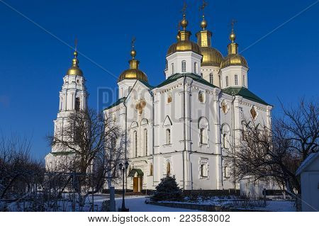 Ancient Holy Cross Exaltation Monastery .General view - white building with golden domes. Poltava. Ukraine. Monument of architecture of national importance. Tourist destination