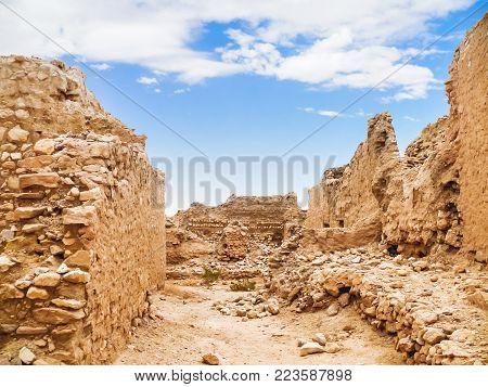 Ancient ruines of berbers town. Oasis Chebika, famous landmark in Sahara desert. Tunisia.