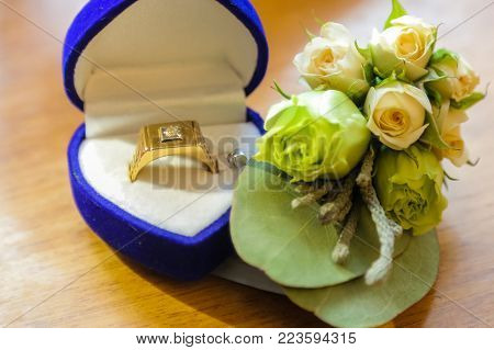 Male gold ring in the box. Wedding Bottom Line.