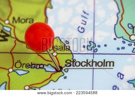 Close-up of a red pushpin on a map of Stockholm, Sweden.