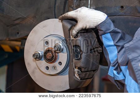 Repair of brake pads on the car. Brake repair
