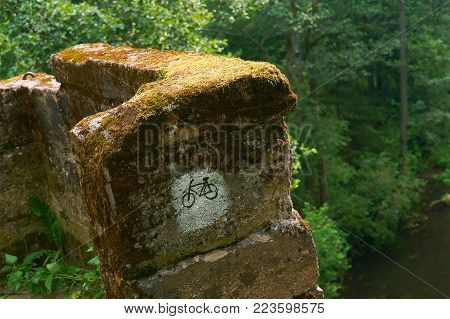 sign a Bicycle route on the stone, marking the route icon bike