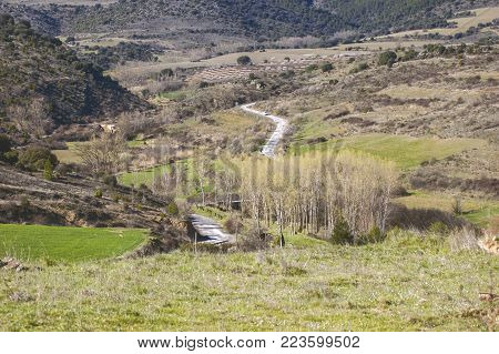 Beautiful wild landscape with some hills and a sinuous road