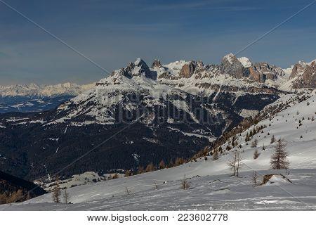Alpe di Lusia, Italy. Dolomites, ski area with beautiful slopes. Empty ski slope in winter on a sunny day. Prepare ski slope.