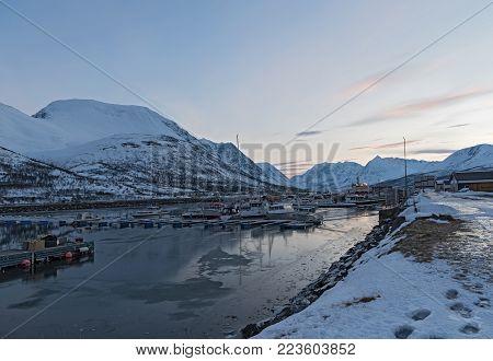 NORD-LENANGEN, NORWAY-JANUARY 21, 2018: Boats in the sheltered harbor at Nord-Lenangen, Lyngen, Troms county, Norway