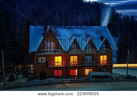 Wooden House In Frosty Day