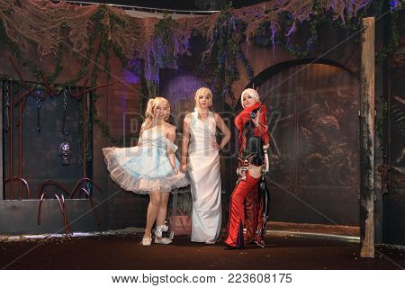 Cologne, Germany - August 24, 2017: Three cosplayer women are posing at the trade fair Gamescom 2017. Gamescom is a trade fair for video games held annually in Cologne.