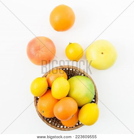 Fruit's background. Citrus fruits - lemon, orange, grapefruit, sweetie and pomelo on white background. Flat lay, top view.