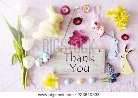 Wooden Sign With English Text Thank You. Sunny Easter Flat Lay With Decoration Like Easter Bunny And Easter Egg. Spring Flower Blossoms Like Tulipa, Daisy And Narcissus.