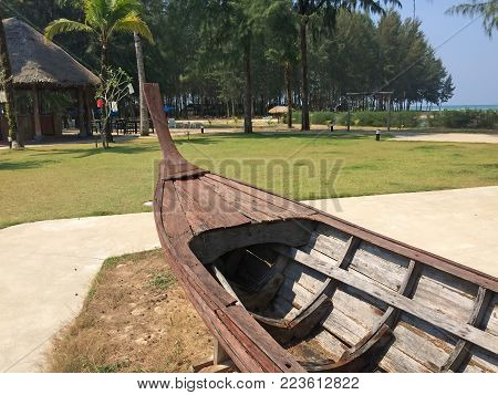 Thailand. Wooden Fishing Boat Ashore In Sunny Day