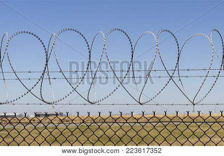 Consecutive heart shapes created by the razor wire at the airport fencing in Brisbane, Australia