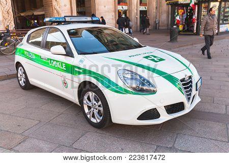 Milano, Italy - January 19, 2018: Alfa Romeo Giulietta, Italian police car patrols Piazza del Duomo, central city square of Milano