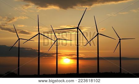 3d render of wind turbines on sunset background
