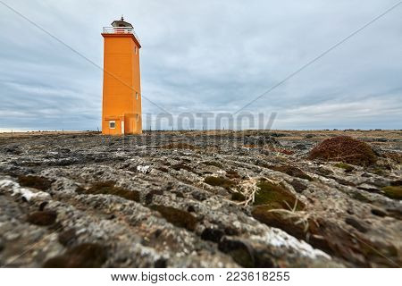 Orange Lighthouse On The Brown Field On The Background Of The Cloudy Sky On Reykjanes Peninsula In I