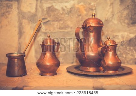 Antique brass retro teapot and coffee set. Vintage filter effect. Copy space.