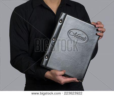 waiter hold the restaurant menu chart.