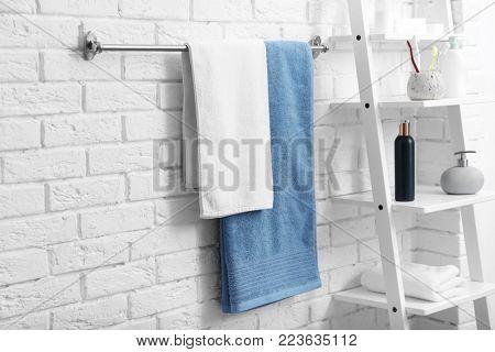 Clean towels on rack in bathroom